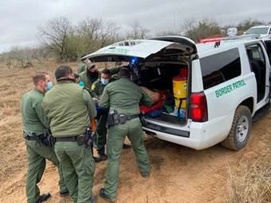 U.S. Border Patrol agents rendered aid to a man who severed part of his foot while attempting to jump on a moving train east of Hebbronville. Photo: Courtesy Photo /U.S. Border Patrol
