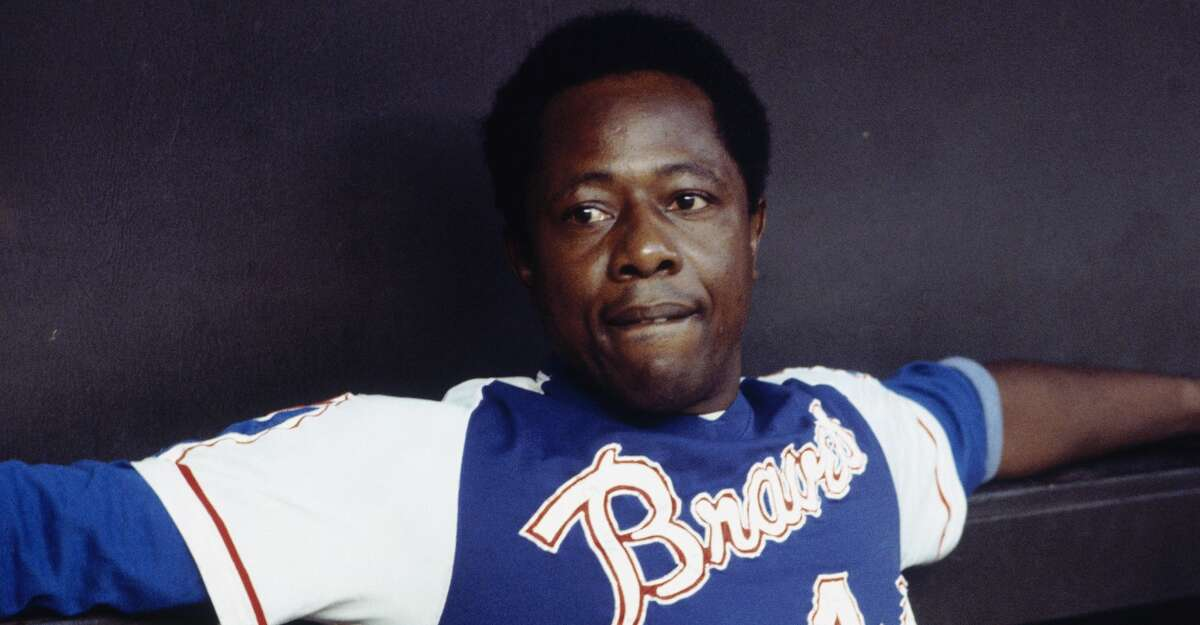 Outfielder Hank Aaron #44 of the Atlanta Braves relaxes in the dugout during a circa 1970s game. (Photo by Focus on Sport via Getty Images)