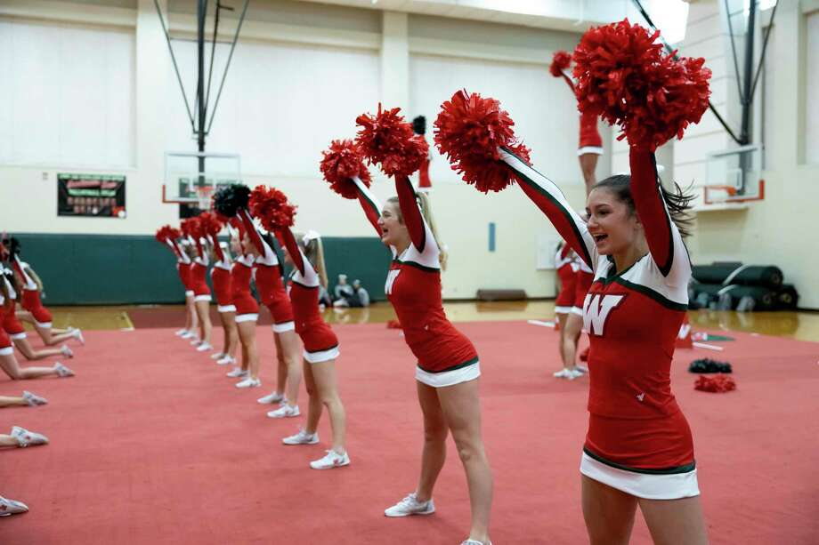 The Woodlands High School cheerleading team practices a routine at The Woodlands High School, Wednesday, Jan. 20, 2021, in The Woodlands. The team came in second at UIL in recent weeks and was the only Conroe team to place. Photo: Gustavo Huerta, Houston Chronicle / Staff Photographer / 2020 © Houston Chronicle
