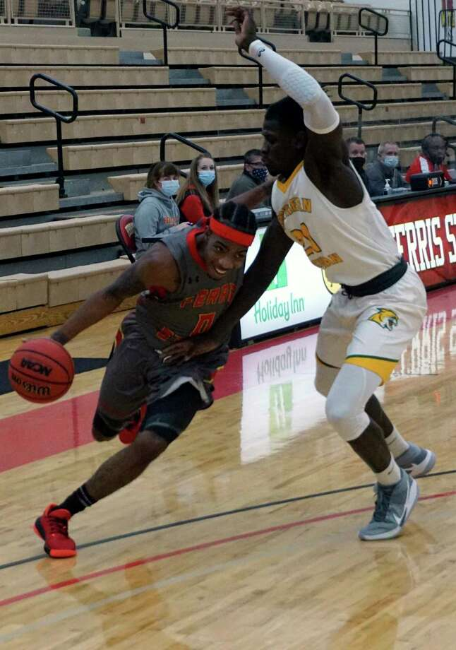 Ferris State's Walt Kelser tries to get past Northern Michigan's Dolapo Olayinka during Friday's game at Wink Arena. (Pioneer photo/Joe Judd)