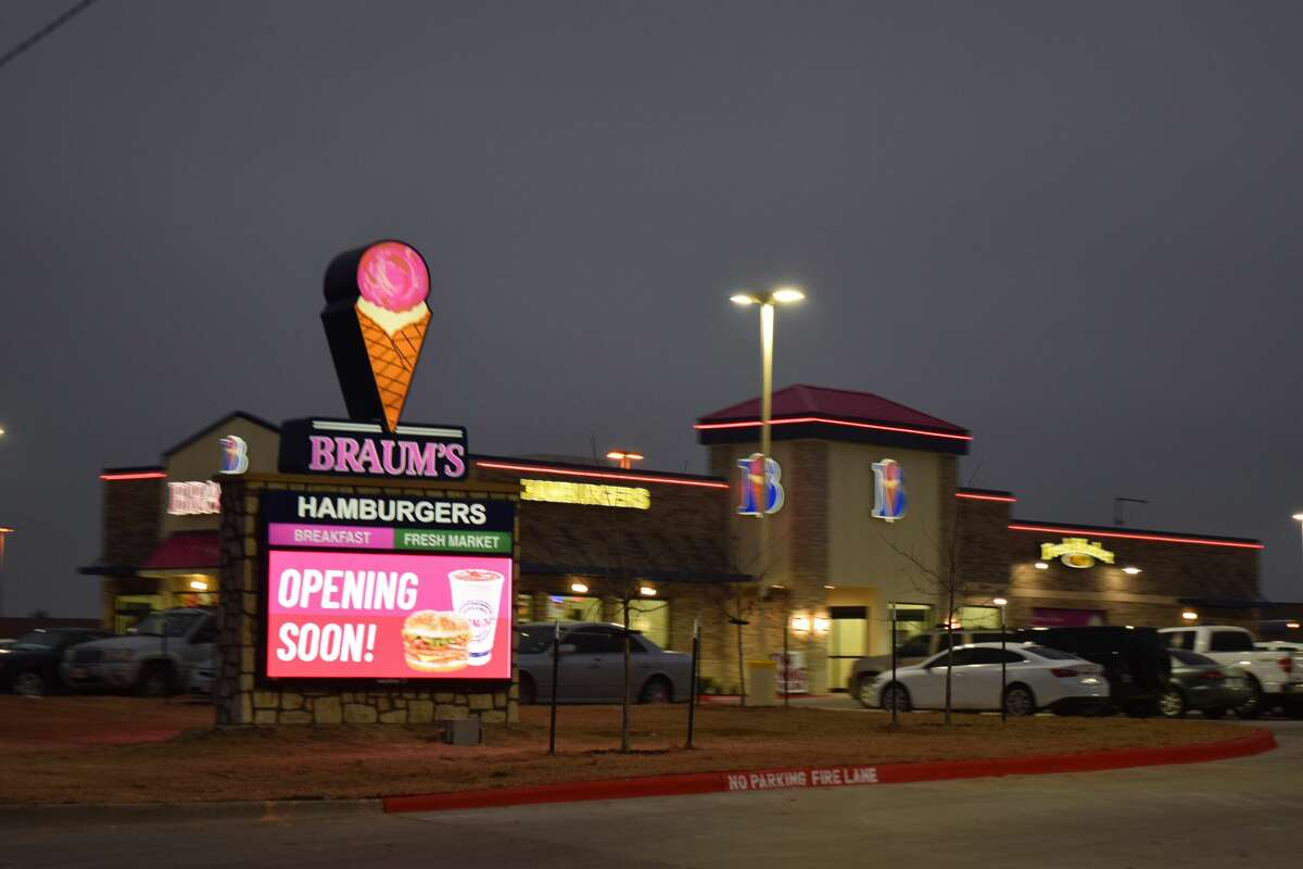 Braum's signage goes up as electronic message board notes opening date.