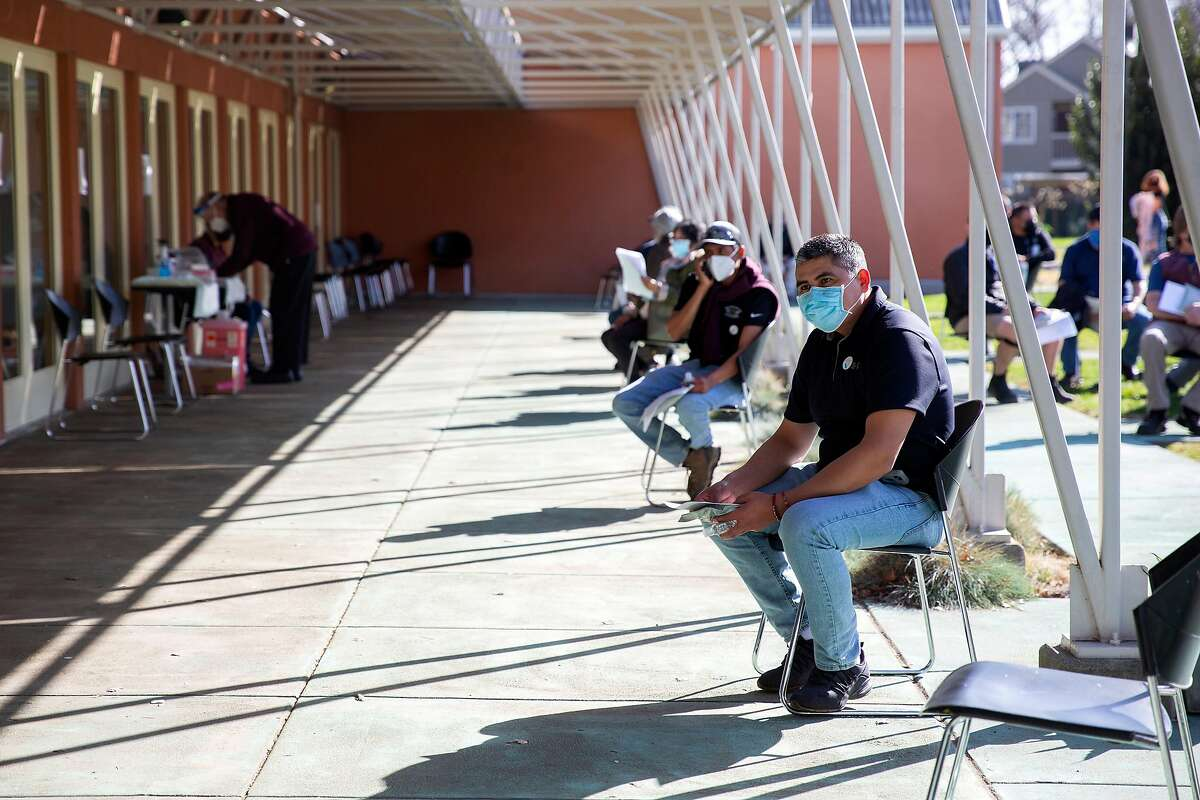 Patients wait to receive their COVID-19 vaccinations at the St. Helena Foundation community clinic at Napa Valley College.