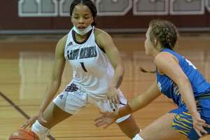 Lee High's Myleah Young brings the ball downcourt as Frenship's Abbi Holder defends 01/22/2021 at the Lee High gym. Tim Fischer/Reporter-Telegram