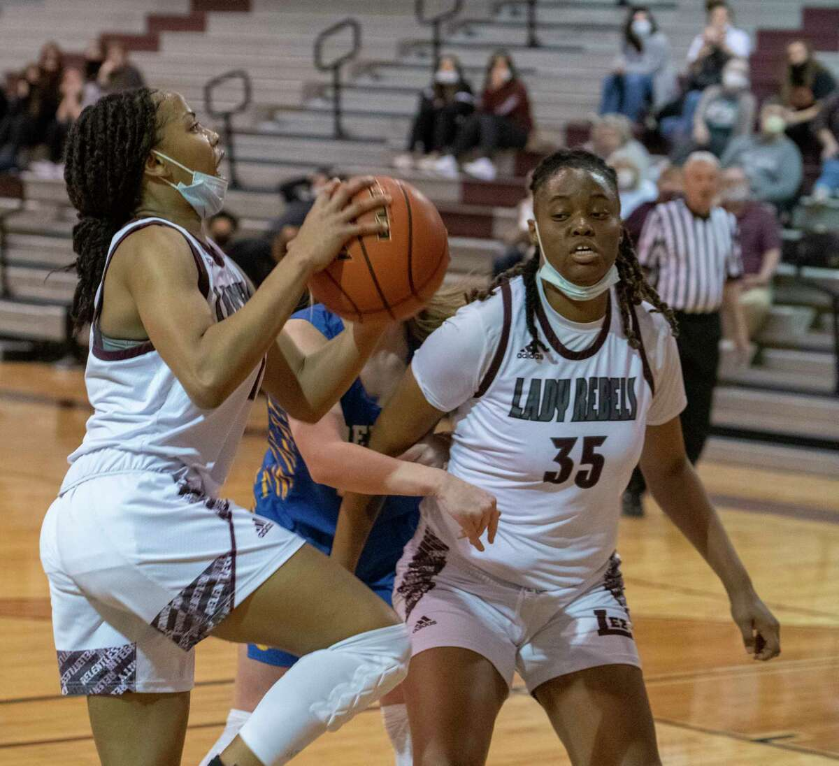 Lee High's Myleah Young drives in for a layup as she gets around a pick by Kamaurie Lee 01/22/2021 at the Lee High gym. Tim Fischer/Reporter-Telegram