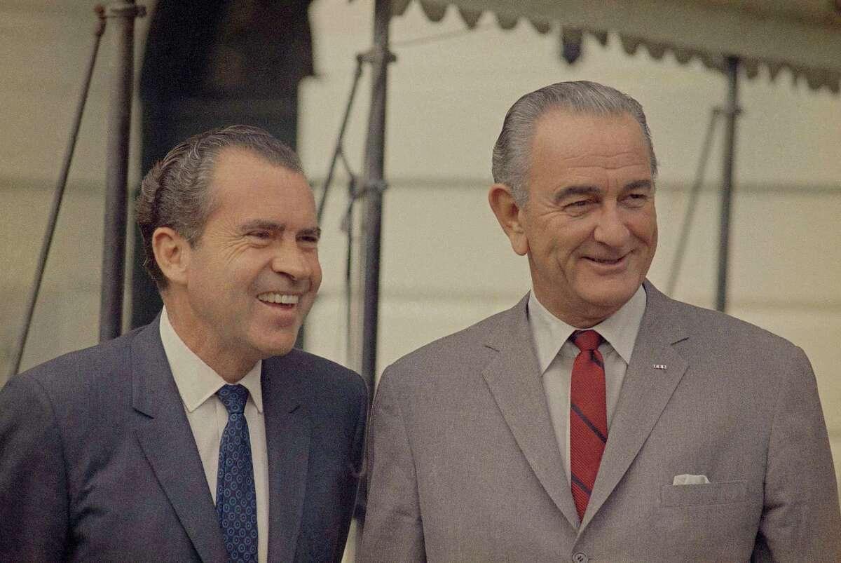 Richard Nixon, left, greets the press with President Lyndon Johnson at the White House in Washington, D.C, on Nov. 6, 1968.