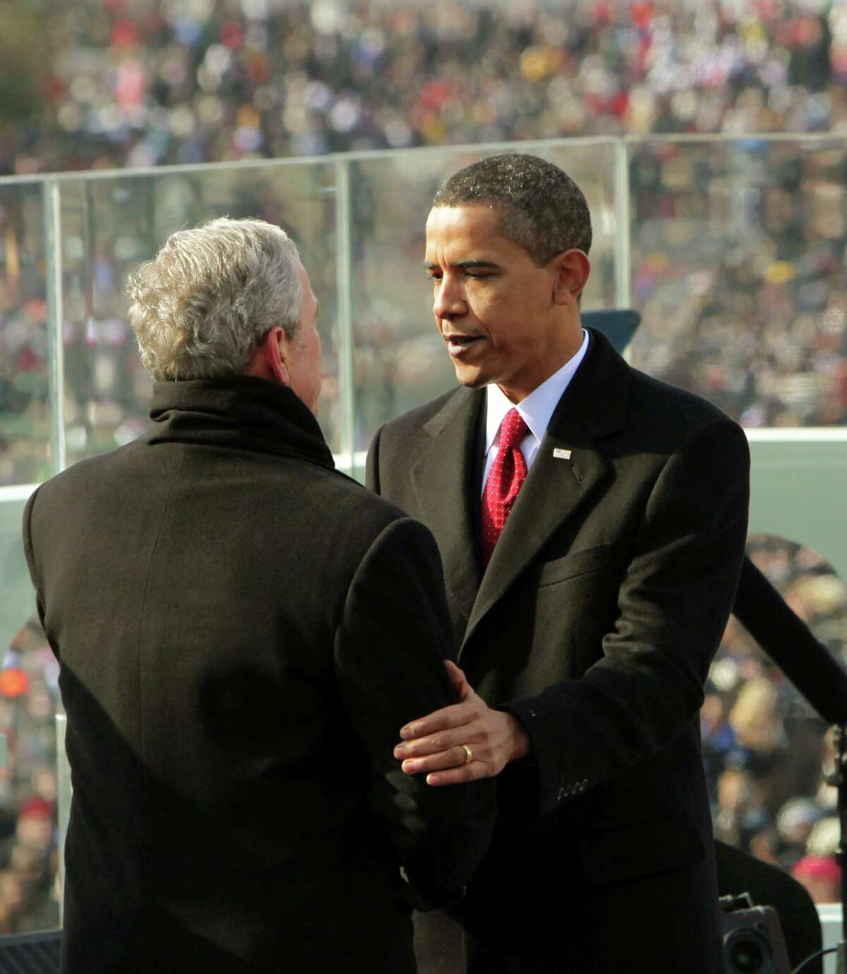 President Barack Obama takes a moment with former President George W. Bush just after Obama was sworn in as the 44th President of the United States and the first African-American to lead the nation at the U.S. Capitol in Washington, Tuesday, Jan. 20, 2009.