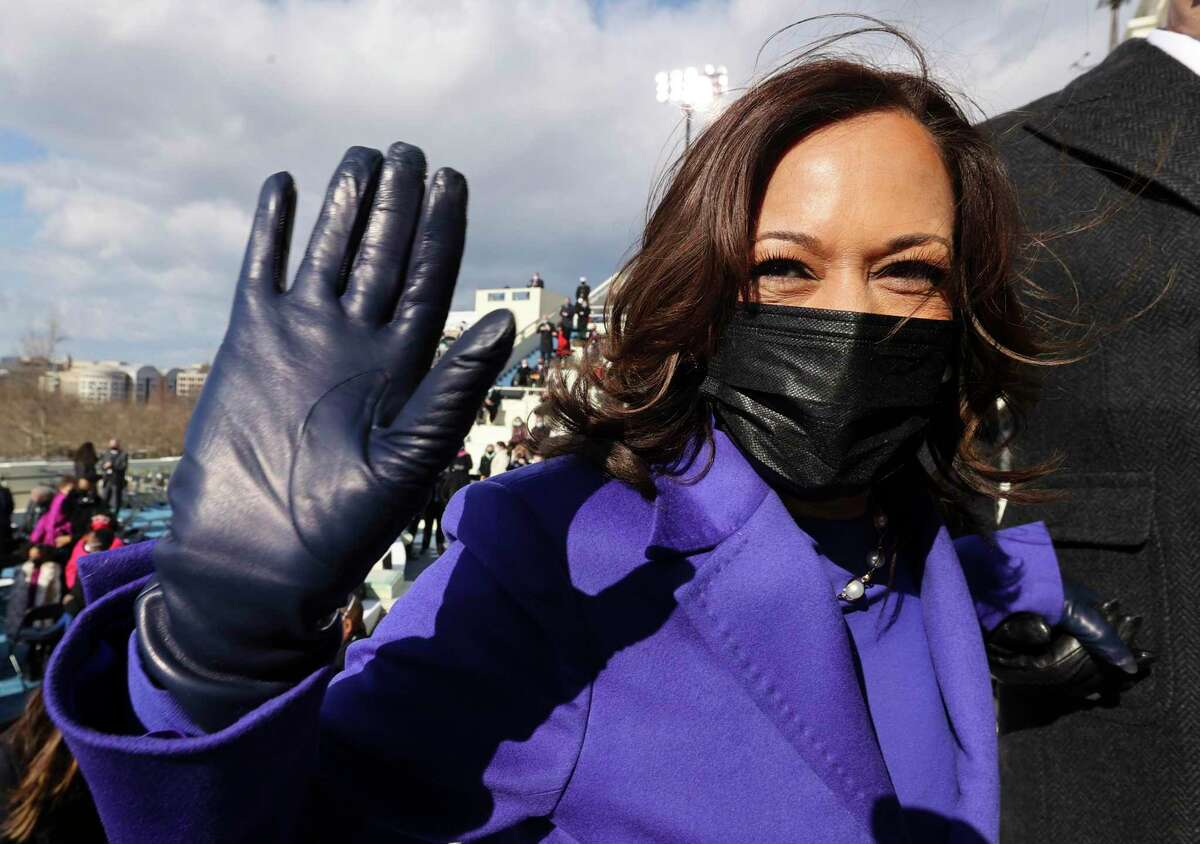 Vice President Kamala Harris accompanied by husband, Doug Emoff, waves as they depart the 59th Presidential Inauguration at the U.S. Capitol in Washington, D.C., Wednesday, Jan. 20, 2021.