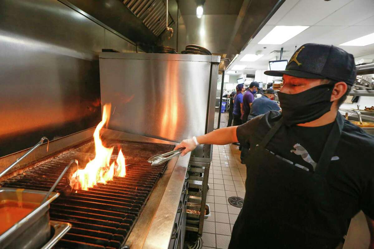 Chef Damian Garcia prepare Espetadas at Peli Peli South African Kitchen - Galleria Friday, Jan. 22, 2021, in Houston. Peli Peli survived the pandemic, but with fewer workers and an adjusted business model.