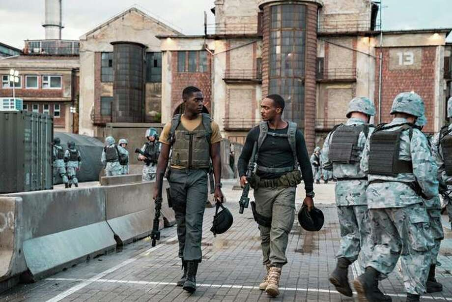"Damson Idris, left, and Anthony Mackie in ""Outside the Wire."" Photo: Jonathan Prime/Netflix"