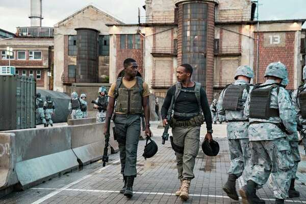 "Damson Idris, left, and Anthony Mackie in ""Outside the Wire."""