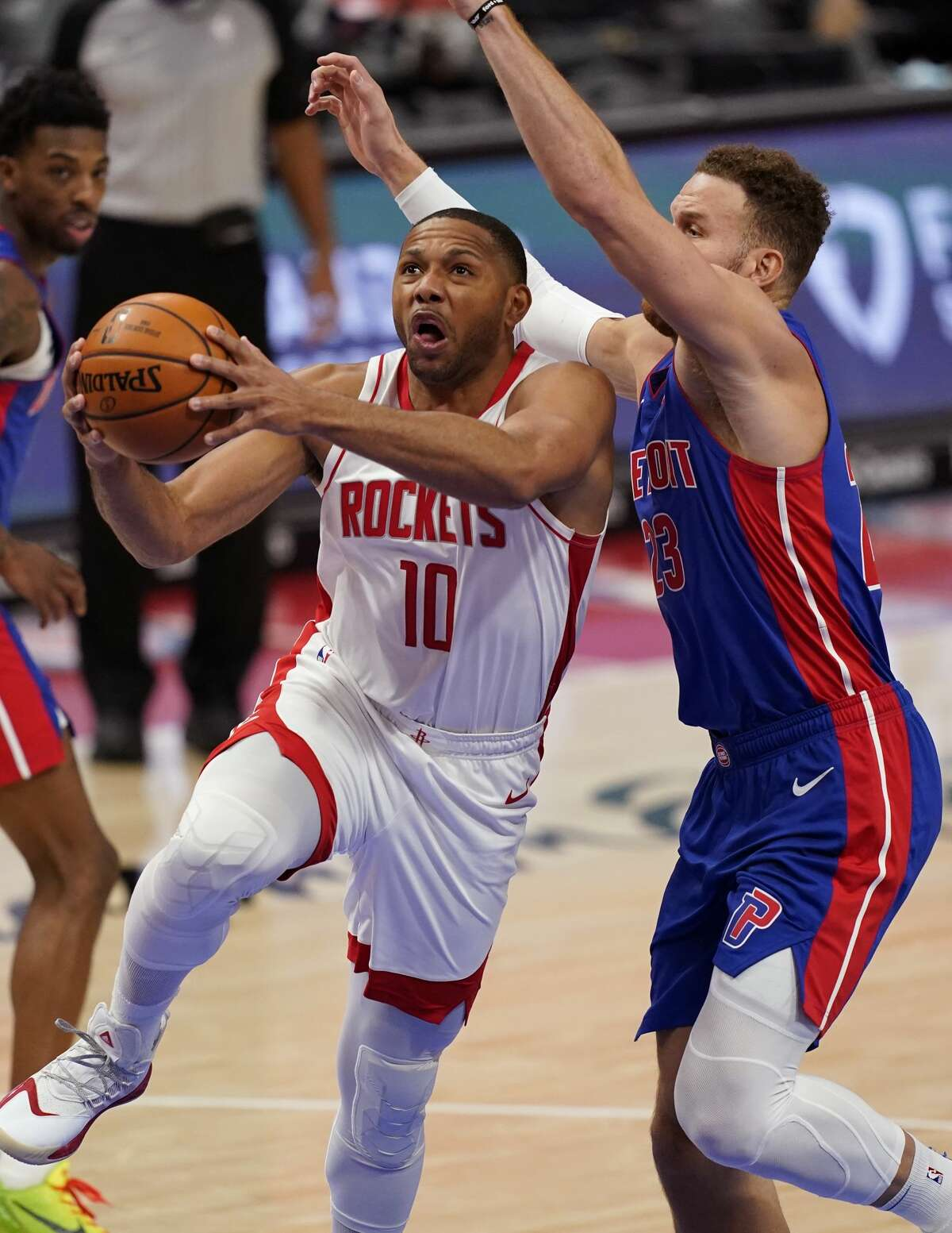 Houston Rockets guard Eric Gordon (10) attempts a layup as Detroit Pistons forward Blake Griffin defends during the second half of an NBA basketball game, Friday, Jan. 22, 2021, in Detroit. (AP Photo/Carlos Osorio)