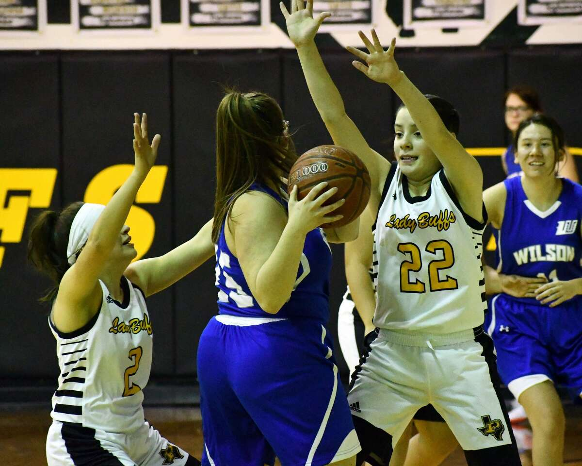 Petersburg's basketball teams rolled to a pair of District 6-1A wins over Wilson on Friday night at Petersburg. The Buffaloes won 97-29 and the Lady Buffs came away with a 59-5 victory.