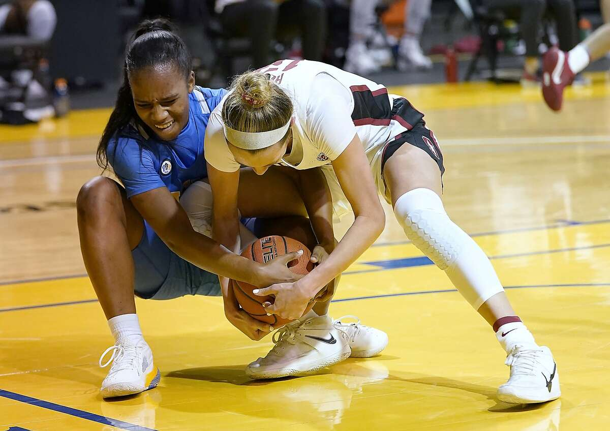 UCLA guard Charisma Osborne, left, and Stanford guard Lexie Hull vie for possession of the ball during the first half of an NCAA college basketball game in Santa Cruz, Calif., Friday, Jan. 22, 2021. (AP Photo/Tony Avelar)