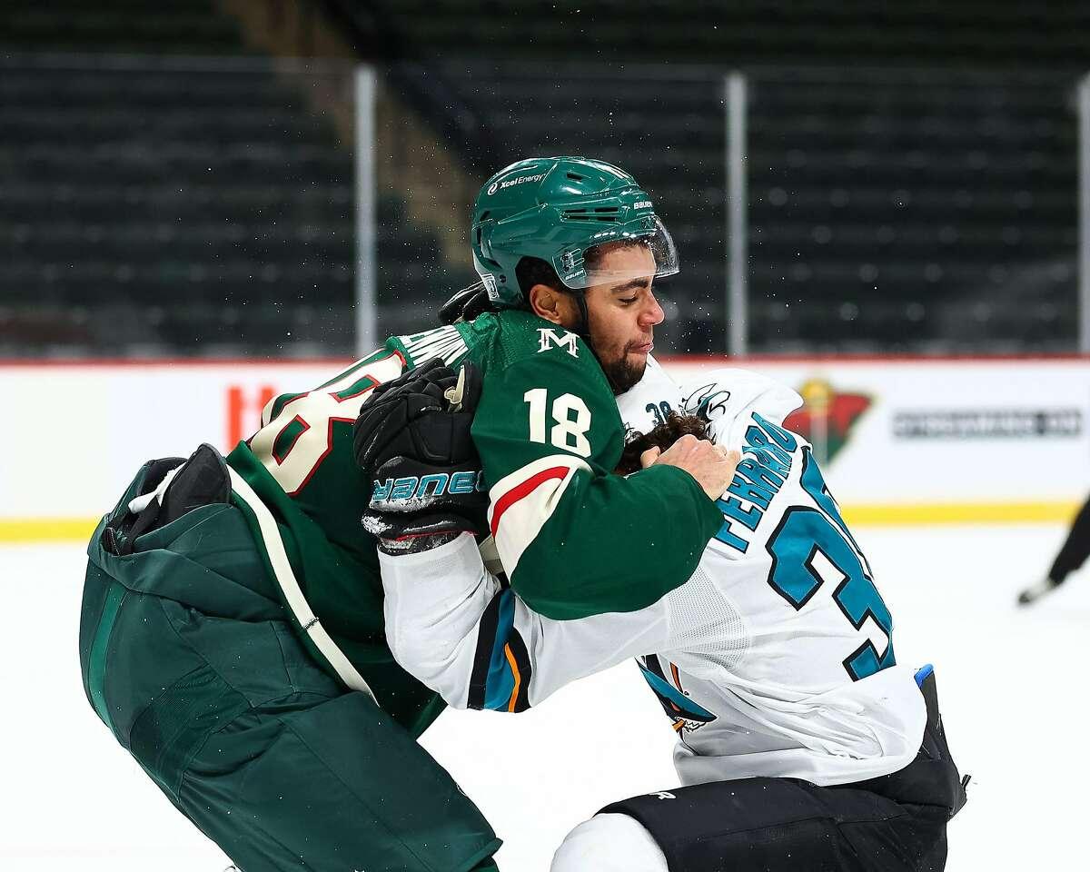Wild forward Jordan Greenway and Sharks defenseman Mario Ferraro fight during Minnesota's 4-1 win Friday.