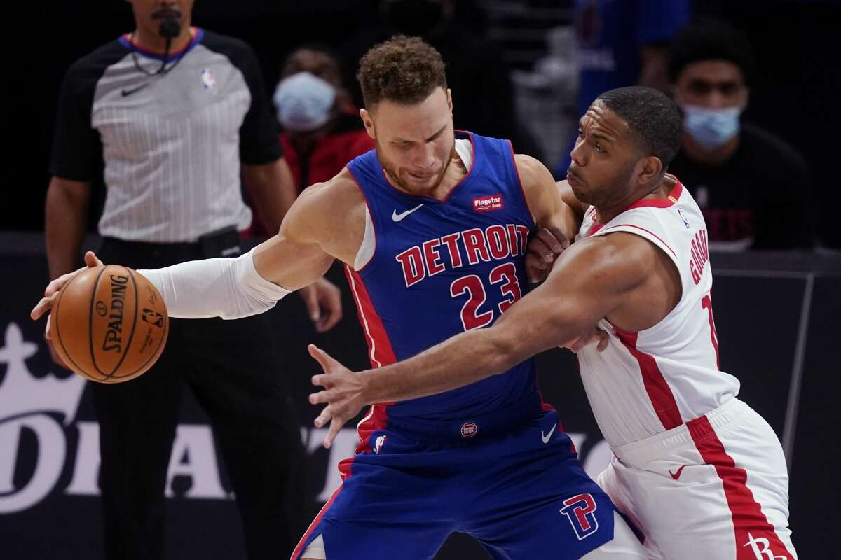Detroit Pistons forward Blake Griffin (23) is defended by Houston Rockets guard Eric Gordon during the second half of an NBA basketball game, Friday, Jan. 22, 2021, in Detroit. (AP Photo/Carlos Osorio)