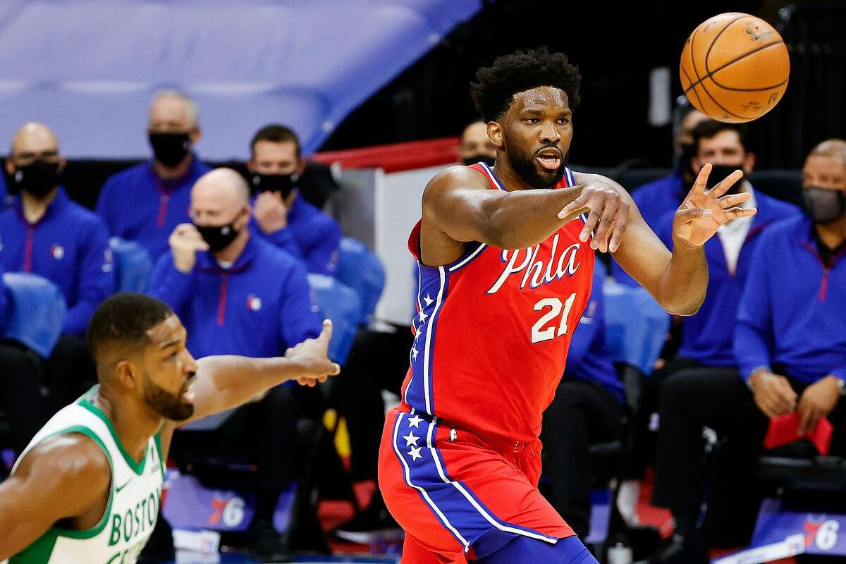 PHILADELPHIA, PENNSYLVANIA - JANUARY 22: Joel Embiid #21 of the Philadelphia 76ers passes during the first quarter against the Boston Celtics at Wells Fargo Center on January 22, 2021 in Philadelphia, Pennsylvania. NOTE TO USER: User expressly acknowledges and agrees that, by downloading and or using this photograph, User is consenting to the terms and conditions of the Getty Images License Agreement. (Photo by Tim Nwachukwu/Getty Images)