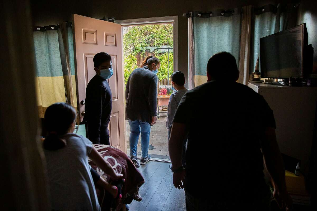 Antonia Lopez (center) with her family at their Mission District apartment.