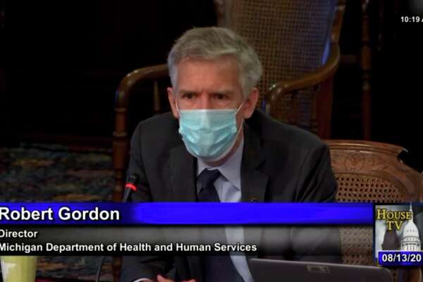 Robert Gordon, director of the Michigan Department of Health and Human Services, addresses lawmaker questions Aug. 13.Gordon announced this resignation Friday afternoon on Twitter.(Screenshot, TNS)