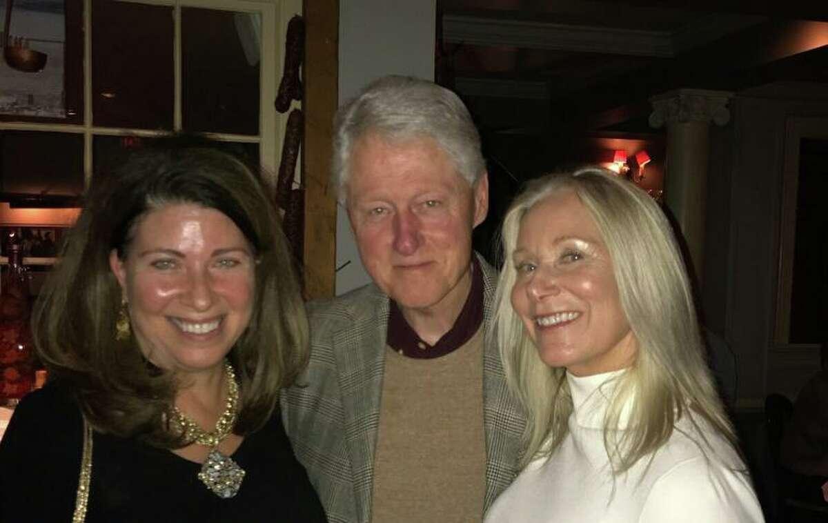 Greenwich residents Linda Castellana and Maryjane Weiss meet former President Bill Clinton at Polpo Restaurant in Greenwich last year.