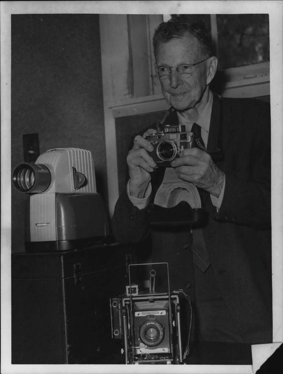 Dr. William D. Coolidge with cameras in Schenectady, New York. October 14, 1963 (Times Union Archive)