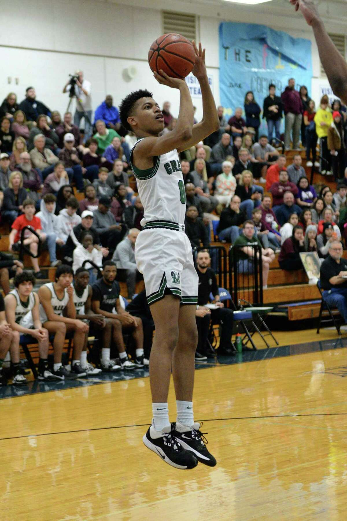 Josh Vanegas (0) of Mayde Creek attempts a jump shot during the second half of a 6A Region III District 19 Boys tie-breaker playoff game between the Cinco Ranch Cougars and the Mayde Creek Rams on Friday, February 21, 2020 at Taylor HS, Katy, TX.