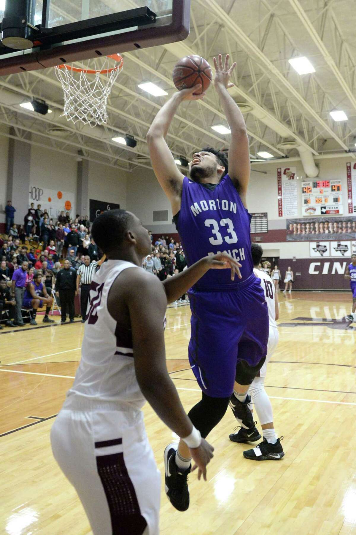 Noah Dickey (33) of Morton Ranch attempts a shot during the second half of a high school basketball game between the Cinco Ranch Cougars and the Morton Ranch Mavericks on Tuesday January 29, 2019 at Cinco Ranch HS, Katy, TX.