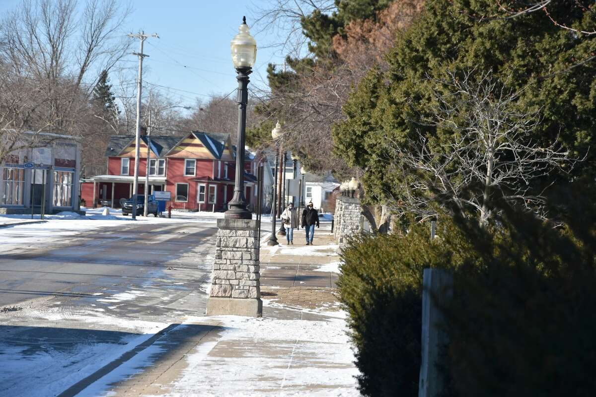 Pedestrians could be seen walking in the sunshine near the marina on Saturday.