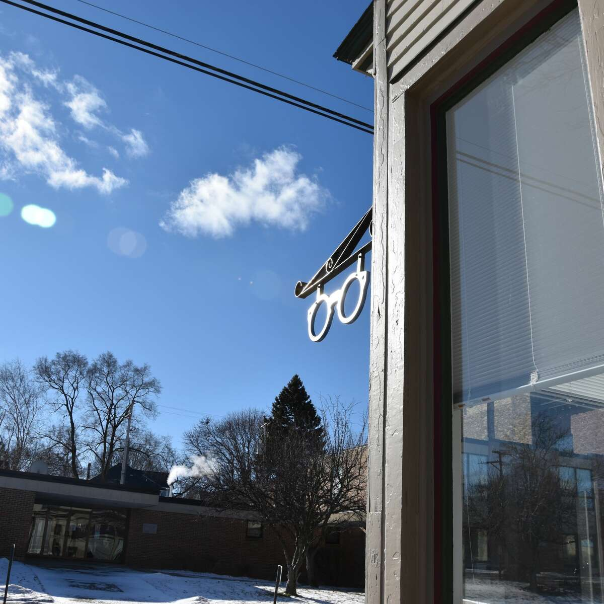 A pair of faux glasses shimmer in the sunlight in front of Coastal Woods Vision on First Street on Saturday.
