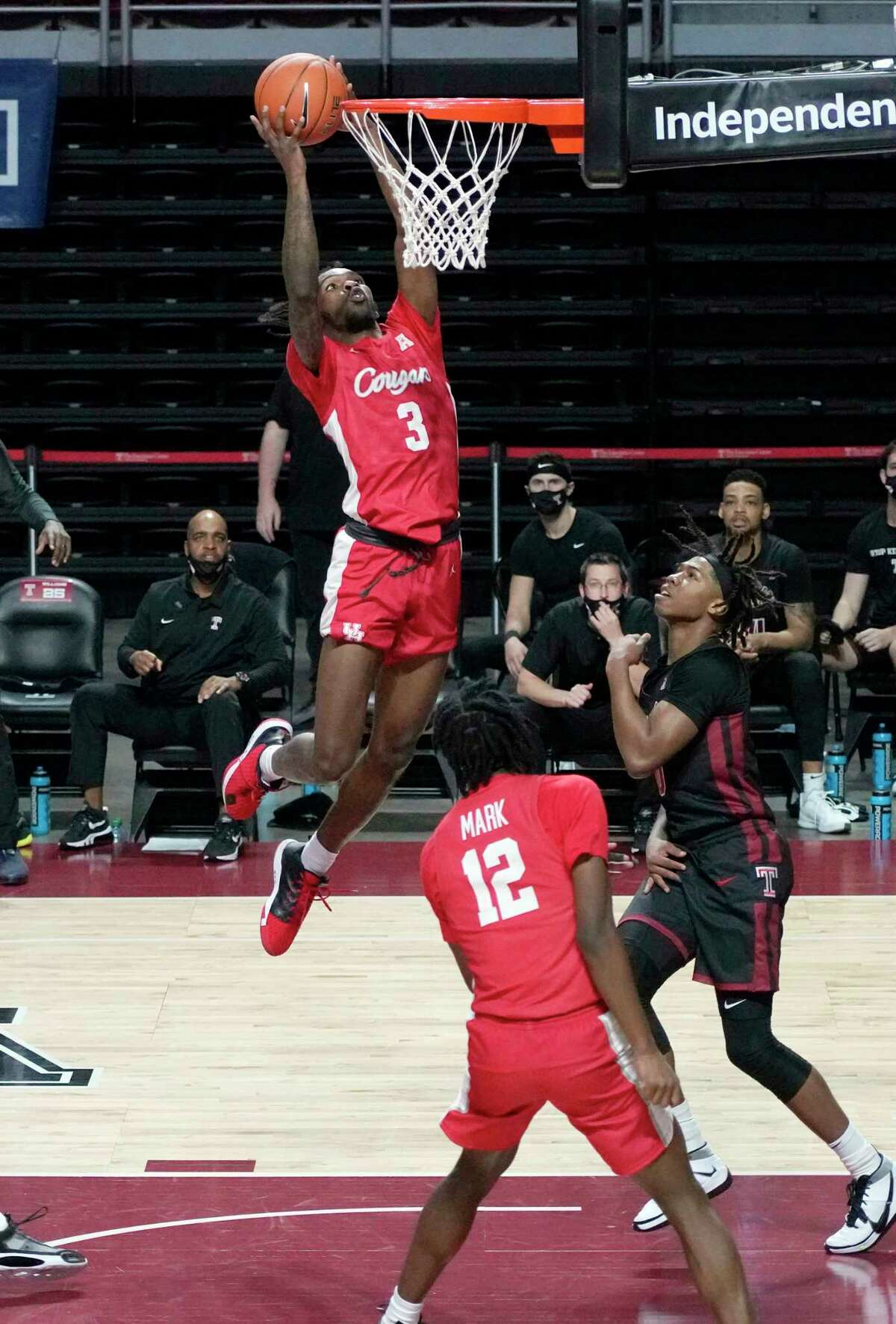 Houston's Houston's DeJon Jarreau (3) takes a shot over Temple's Khalif Battle (0) in the first half of an NCAA college basketball game, Saturday, Jan. 23, 2021, in Philadelphia.