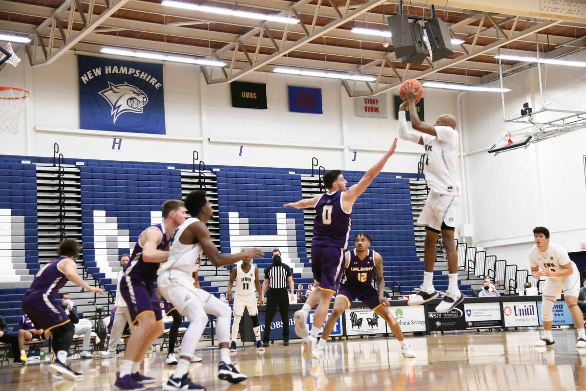 New Hampshire's Marque Maultsby misses a shot over the outstretched arm of UAlbany defender Antonio Rizzuto in the first half of an America East basketball game Saturday, Jan. 23, 2021, at Lundholm Gymnasium in Durham, N.H. (Larissa Biette/UNH athletics)
