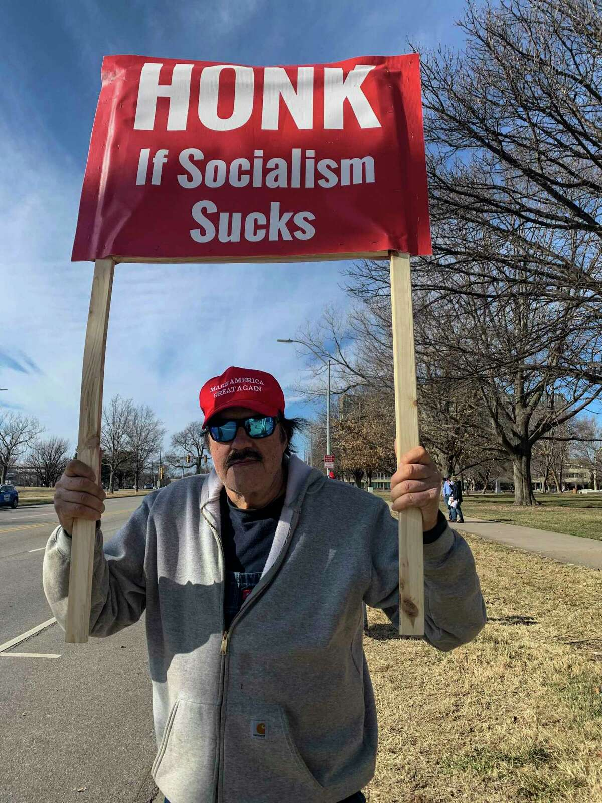 Trump supporter Ed Myers, 70, stands outside the Kansas Capitol in Topeka on Wednesday.
