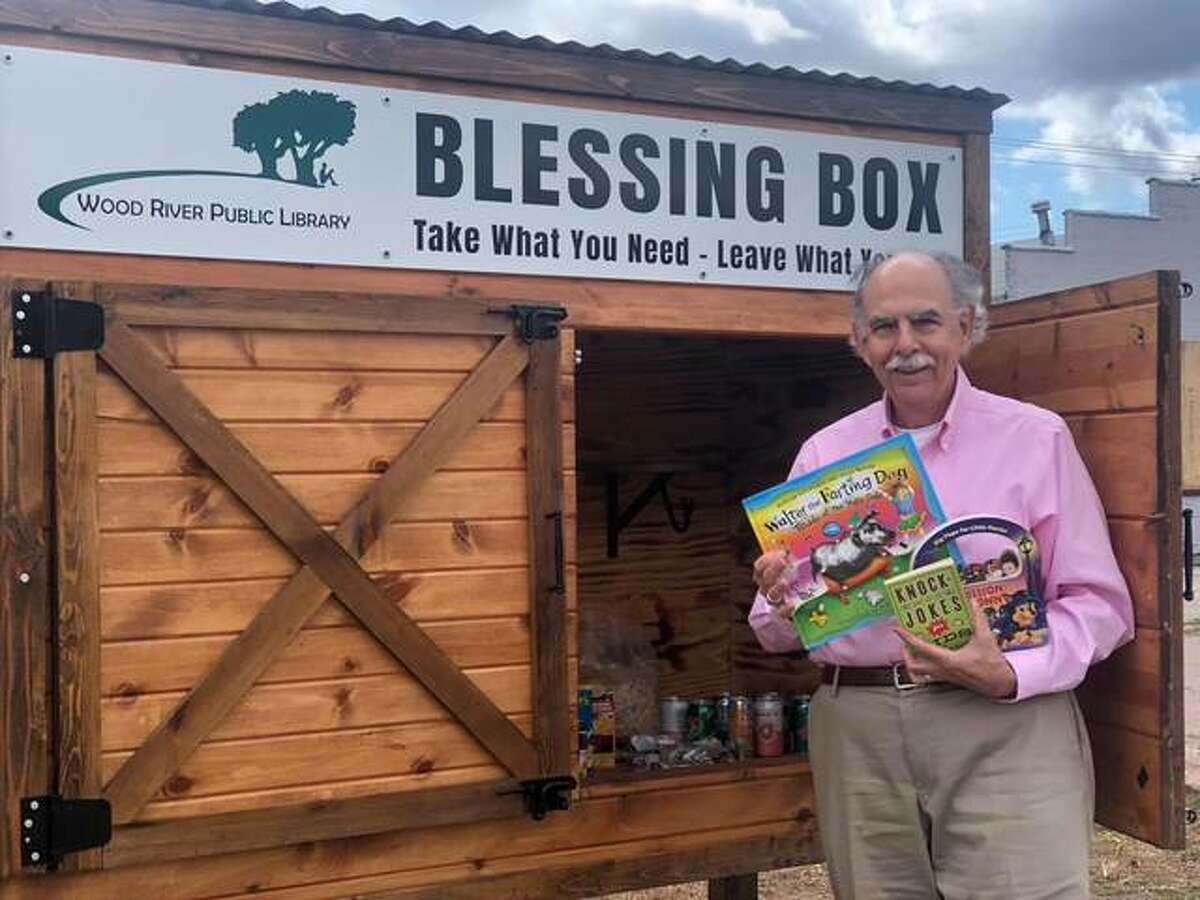 In this May photo, Rotarian Leonard Berg drops off children's books at the Wood River Library's Blessing Box. Rotary clubs in Wood River and East Alton have merged to become the Riverbend East Rotary Club.