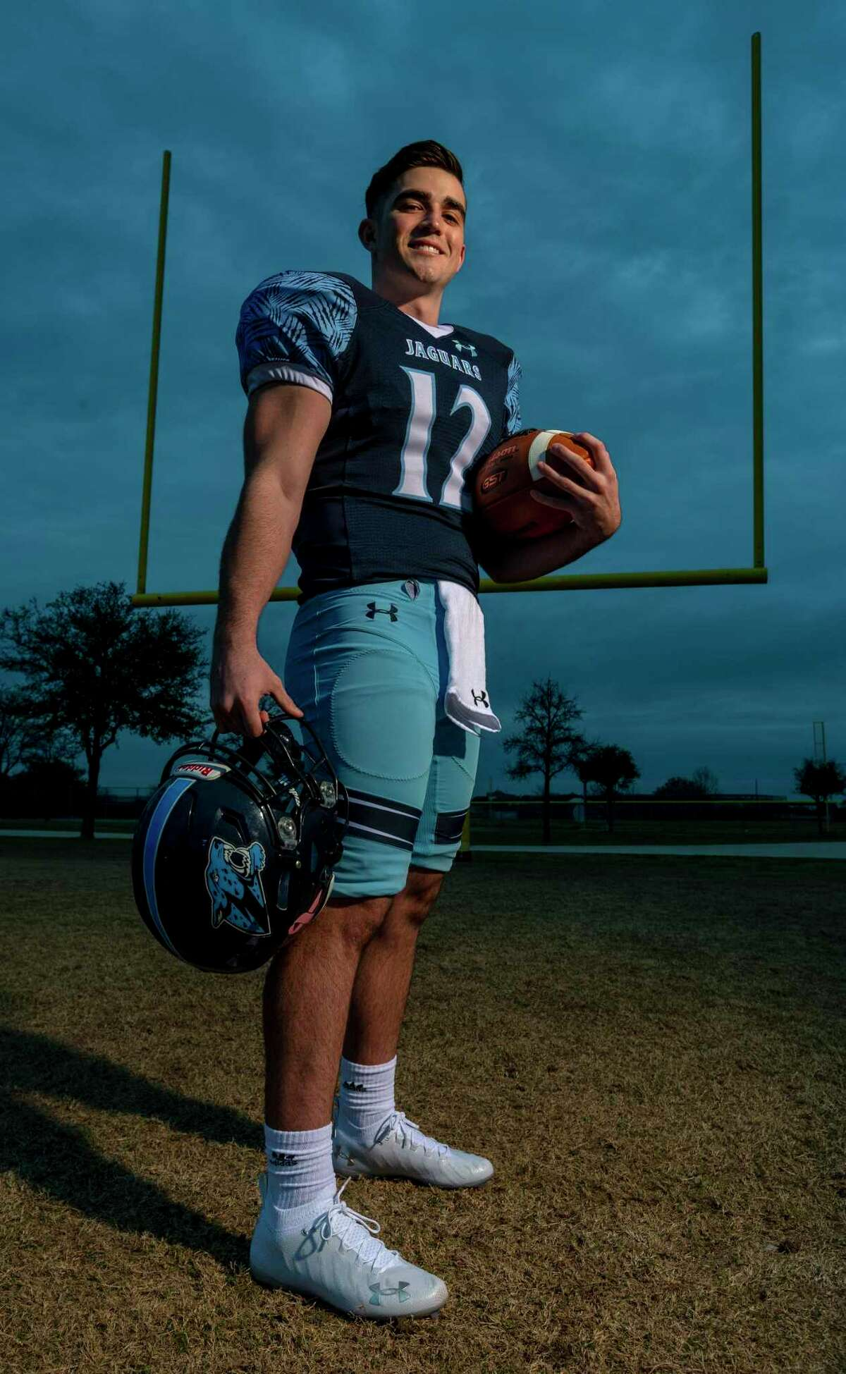 Express-News Offensive Player of the Year Johnson High School quarterback Ty Reasoner poses Thursday, Jan. 21, 2021 on the school's practice field.
