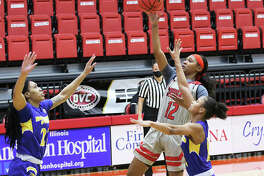 SIUE's Mikayla Kinnard (12), shown putting up a runner between two Morehead State defenders in a Jan. 16 game at First Community Arena in Edwardsville, scored a team-high 17 points Saturday afternoon in the Cougars' OVC loss to Belmont in Nashville, Tenn.