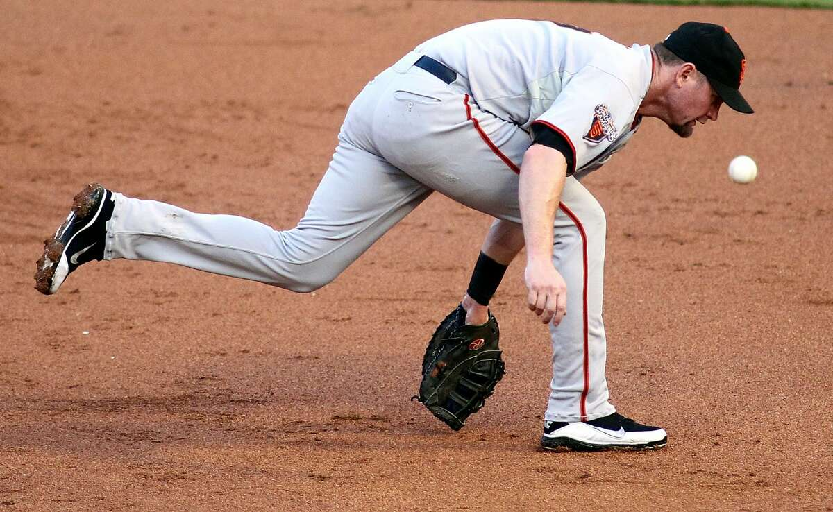 First baseman Aubrey Huff of the San Francisco Giants cannot make the play against the Florida Marlins on Aug. 12, 2011.