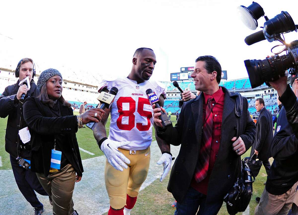 Vernon Davis of the San Francisco 49ers is interviewed after the NFC Divisional Playoff Game against the Carolina Panthers on Jan. 12, 2014.