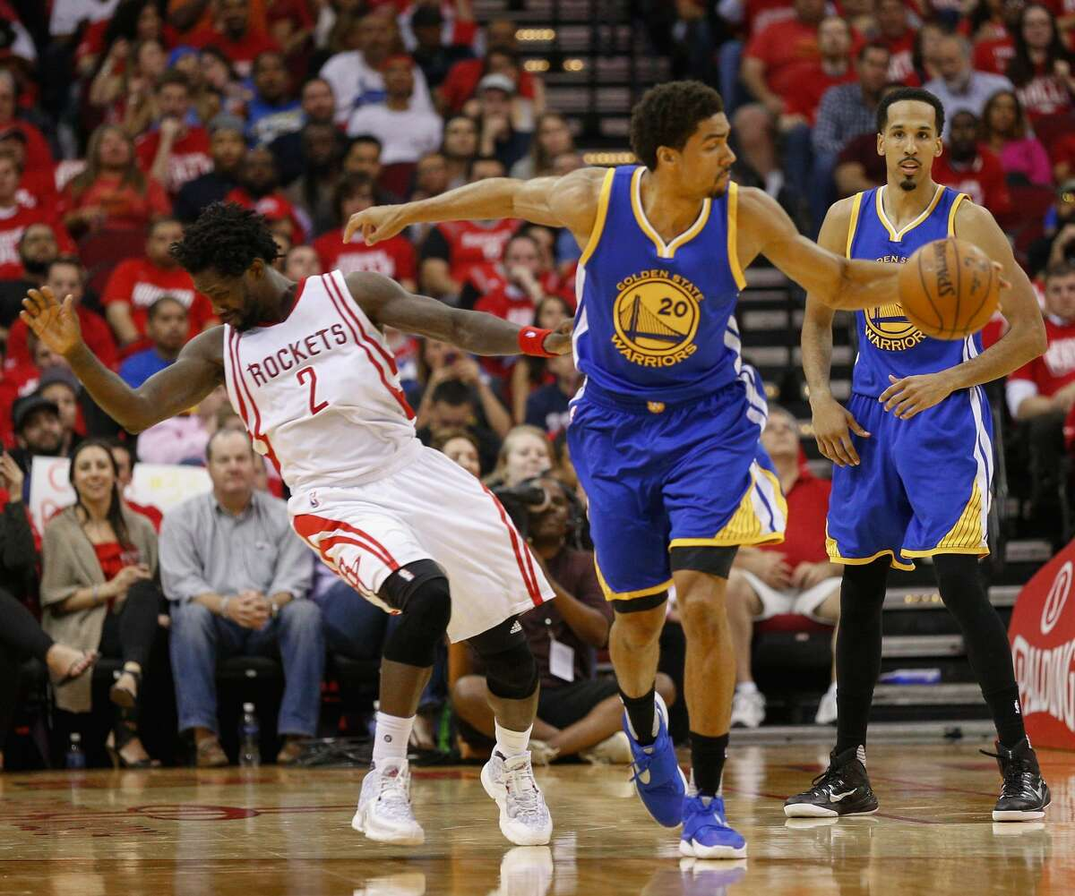 Patrick Beverley of the Houston Rockets takes a forearm from James Michael McAdoo of the Golden State Warriors on April 21, 2016.