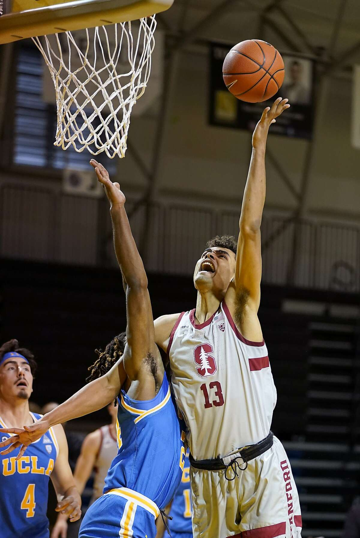 Stanford forward Oscar da Silva drives to the basket against UCLA forward Jalen Hill (24) during the first half.