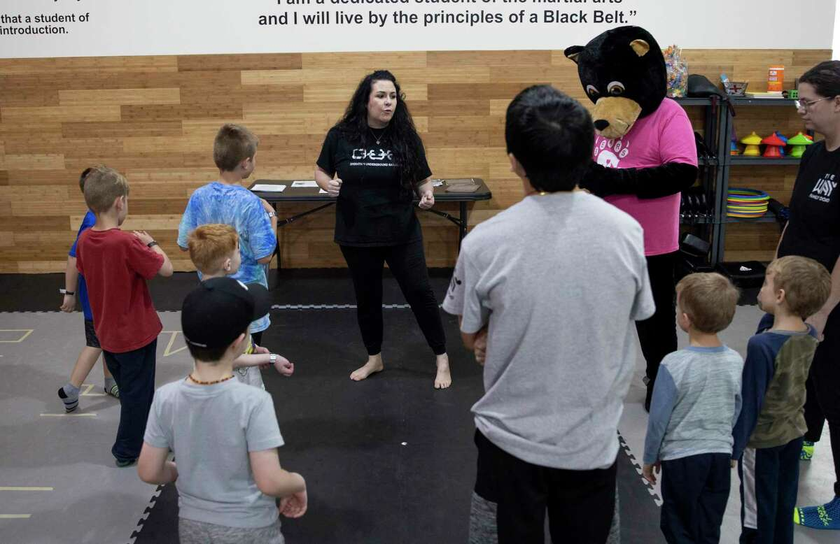 Master Tisha Butler, center, speaks with children during a 15 minute self-defense course held at The Way Family Dojo in partnership with Operation Underground Railroad, Saturday, Jan. 23, 2021, in Magnolia. Operation Underground Railroad is an organization in the Houston area to assist in the ending of human trafficking.