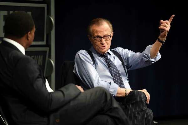 """Larry King is interviewed by Leon Harris, left, at the Newseum in downtown Washington, D.C., for a special event, """"A Life in Broadcasting: A Conversation With Larry King,"""" in March 2015."""