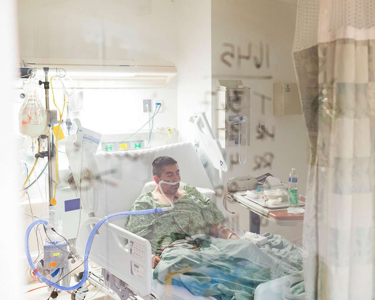 Francisco Hernández, a 48-year-old Moss Landing resident, rests inside a COVID unit at Salinas Valley Memorial Hospital.