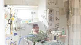 Francisco Hernandez, a 48-year-old Moss Landing resident, rests inside a COVID unit at Salinas Valley Memorial Hospital in Salinas, Calif on Jan. 14, 2021. He was brought into the hospital on Jan. 13.