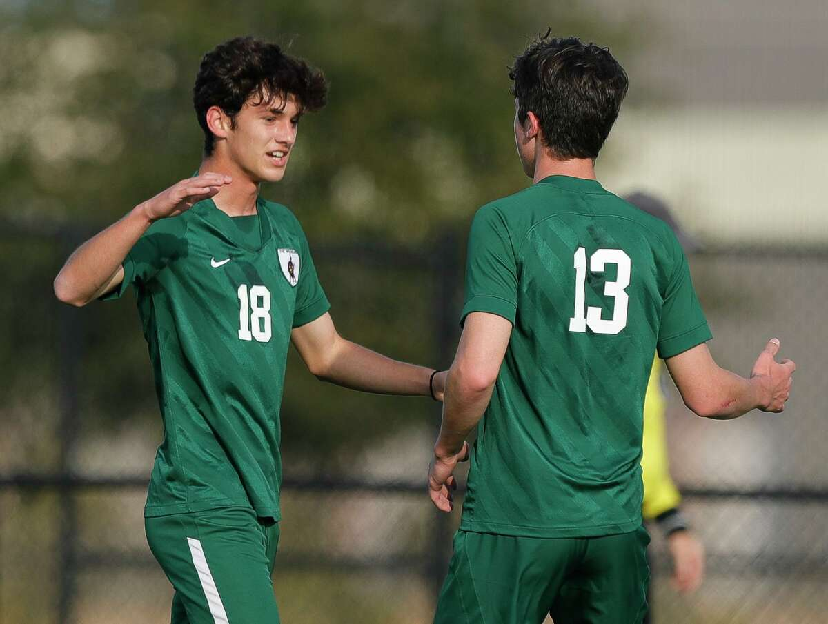 FILE PHOTO -- Reinaldo Perera (18) and Cody Tice (13) during the first period of a match during the Kilt Cup soccer tournament, Friday, Jan. 8, 2021, in Shenandoah.