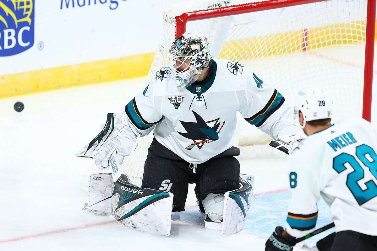 ST PAUL, MN - JANUARY 22: Devan Dubnyk #40 of the San Jose Sharks makes a save during the third period against the Minnesota Wild at Xcel Energy Center on January 22, 2021 in St Paul, Minnesota. (Photo by Harrison Barden/Getty Images)