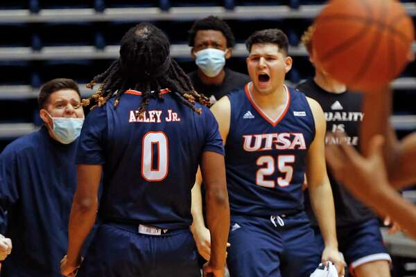 UTSA forward Cedrick Allen receives praise from teammates including UTSA forward Adrian Rodriguez after his rebound led to a basket. UTSA vs Southern Miss on Saturday, January 23,3032. UTSA 78 Southern Miss 72