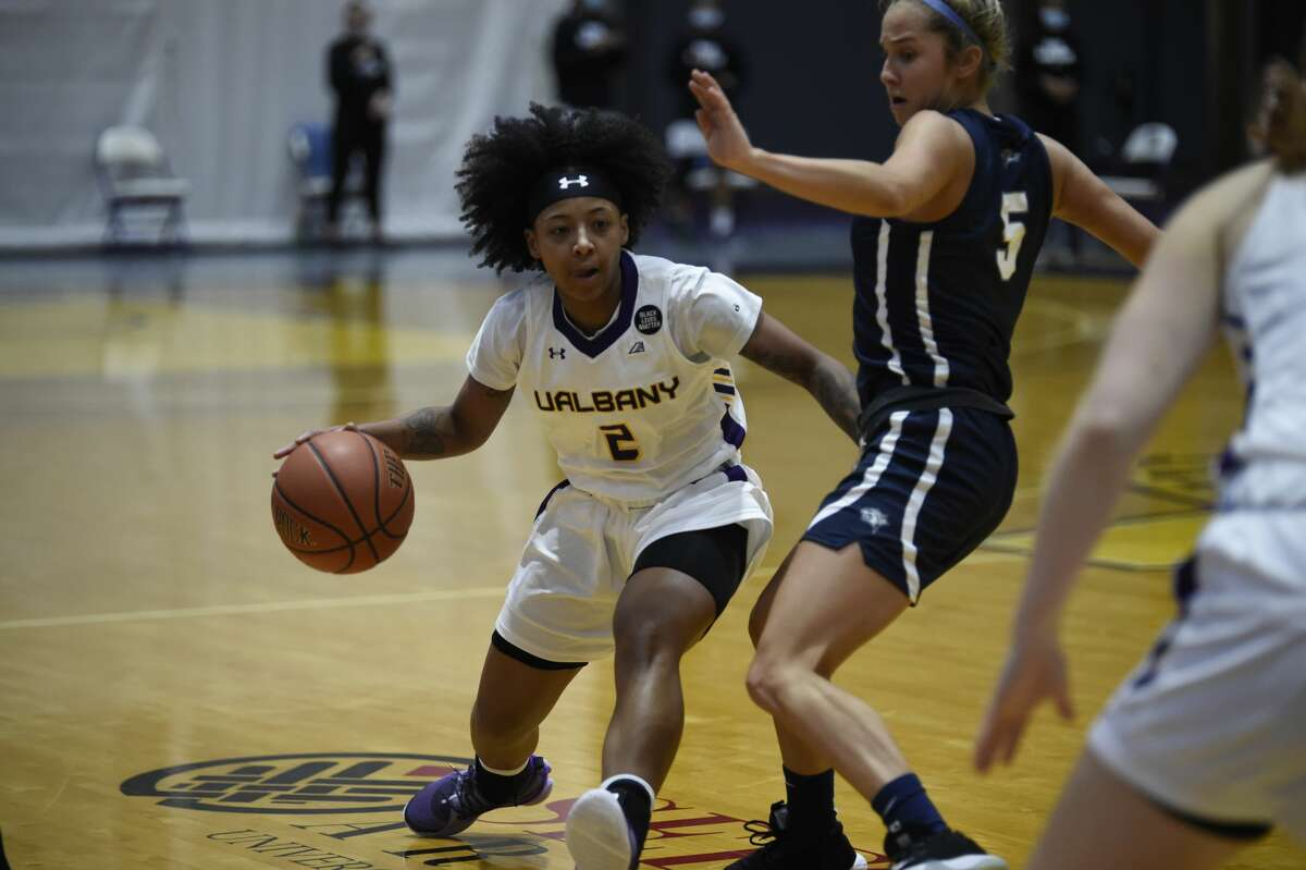 UAlbany's Kyara Frames drives around New Hampshire's Amanda Torres in an America East women's basketball game Saturday, Jan. 23, 2021, at SEFCU Arena in Albany. (Kathleen Helman/UAlbany athletics)