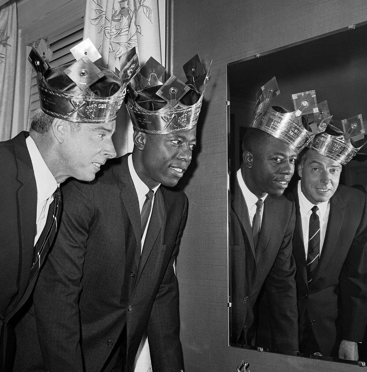 """Scott Ostler says Hank Aaron was his generation's Joe DiMaggio. They are shown wearing """"Sultan of Swat"""" crowns in 1964. Vin Scully, however, called Aaron """"Bad Henry."""""""