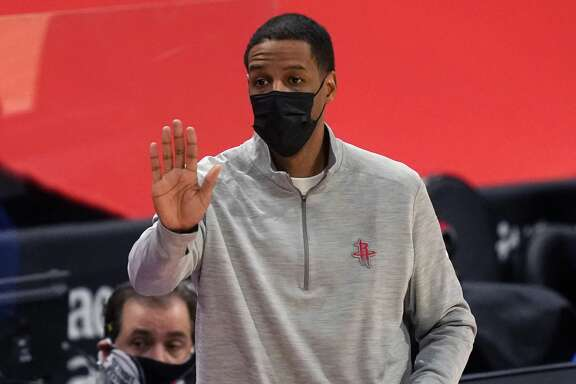 Houston Rockets head coach Stephen Silas signals from the sideline during the first half of an NBA basketball game against the Detroit Pistons, Friday, Jan. 22, 2021, in Detroit. (AP Photo/Carlos Osorio)