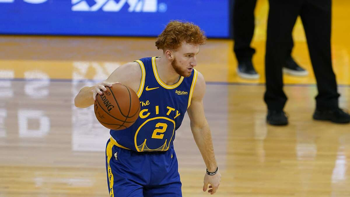 Golden State Warriors guard Nico Mannion against the New York Knicks during an NBA basketball game in San Francisco, Thursday, Jan. 21, 2021. (AP Photo/Jeff Chiu)