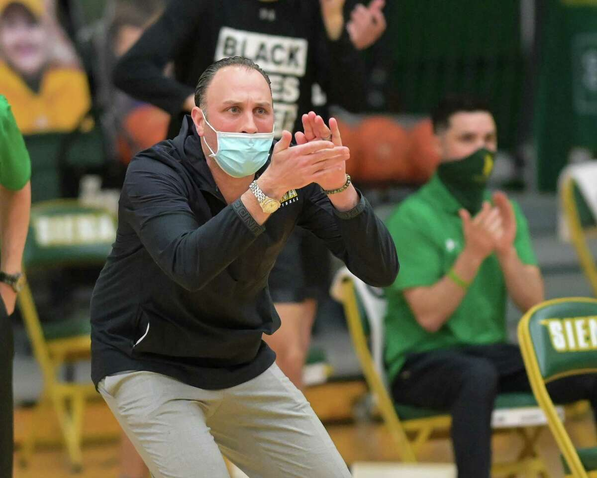 Siena College coach Carmen Maciariello cheers on his team during a Metro Atlantic Athletic Conference game against St. Peter's on Saturday, Jan. 23, 2021. Maciariello said his team is not worrying about things it can't control, like schedule changes. (Jim Franco/Special to the Times Union)